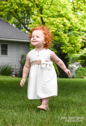 Confident Red-Haired Girl in a White Party Dress