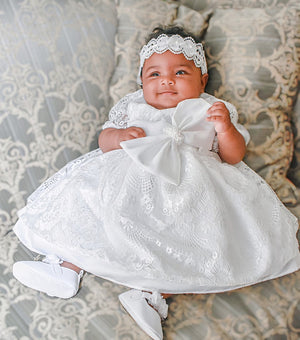 Baby Wearing a Headband in a White Satin Dress