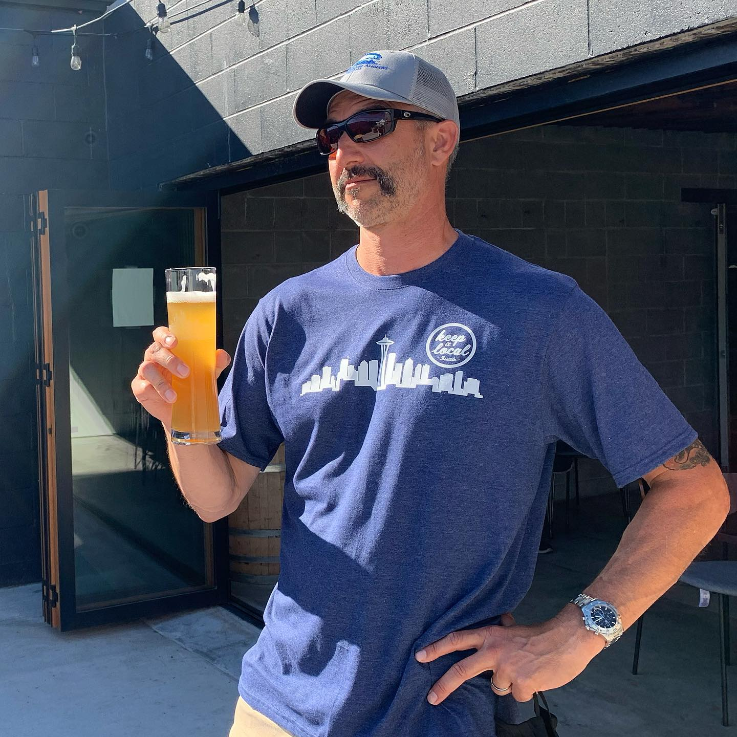 Stylish gentleman with a mustache, craft brew, and a Limited Edition Keep It Local Seattle T-Shirt
