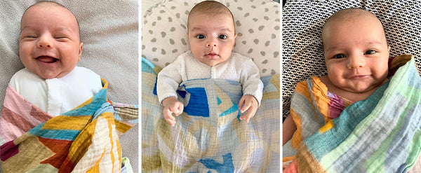 Babies wrapped in swaddle or blanket with the word LOVE on it