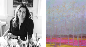 Artist Sunny Goode leaning over her art supplies while painting. Next to an oil on canvas of trees with a purple sky and pink ground.