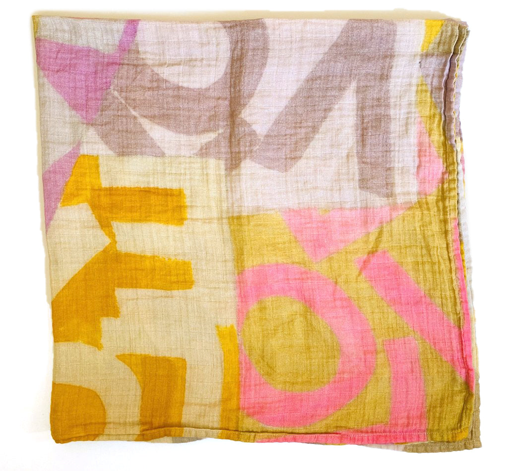 """Wrapping your baby in LOVE"" ™  100% organic cotton muslin swaddles covered in Sunny's Love Layers, and Lovevolve artwork are produced using Fair Trade Fabrics, in an ethically principled factory. The Inks are Azzo free and there is zero waste.  45 x 45 inches  Machine wash cold  Warm dryer"