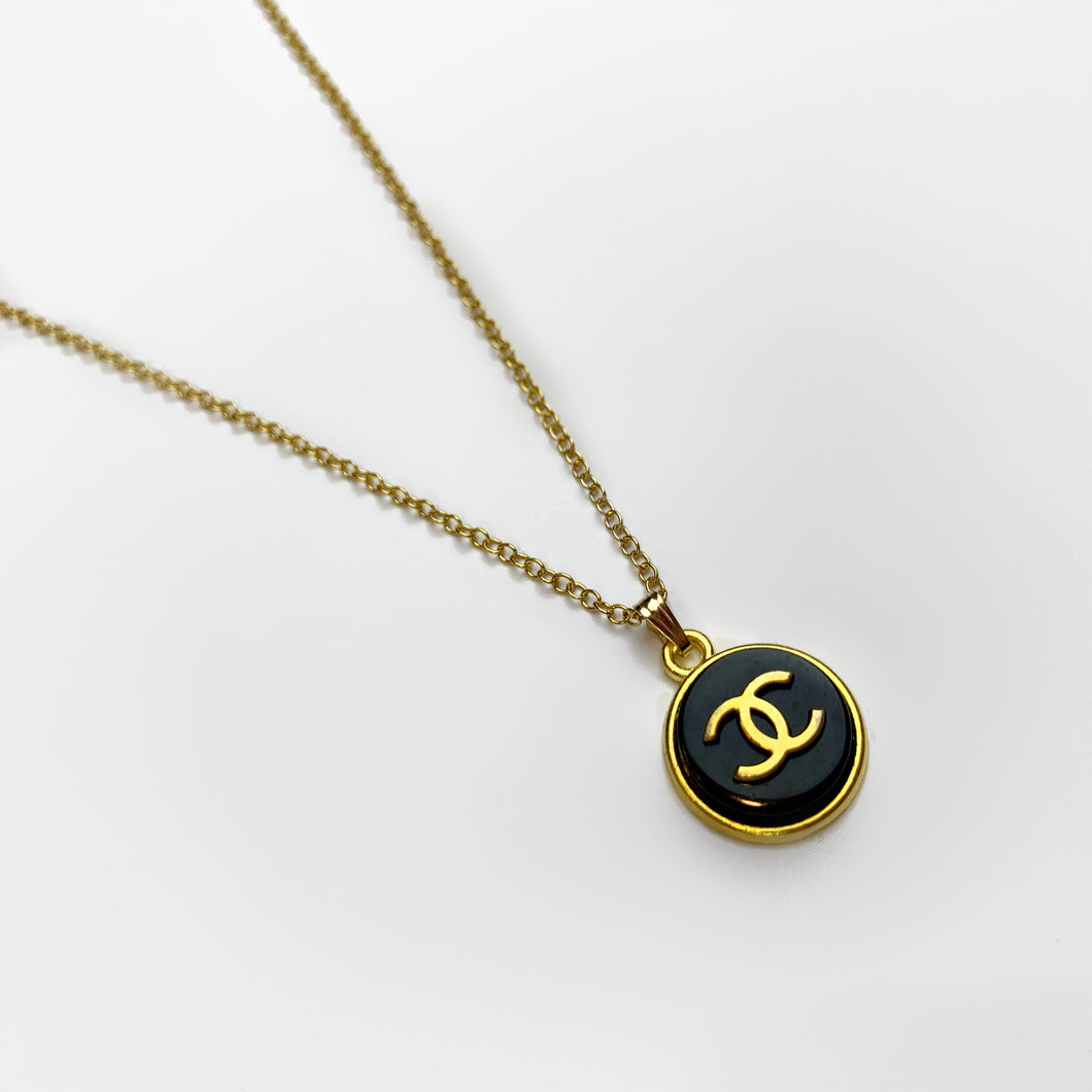 Black and gold baby pendant