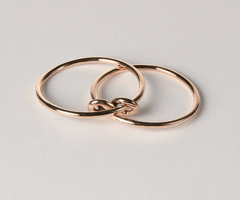 silver infinity ring with yellow gold infinity sigh