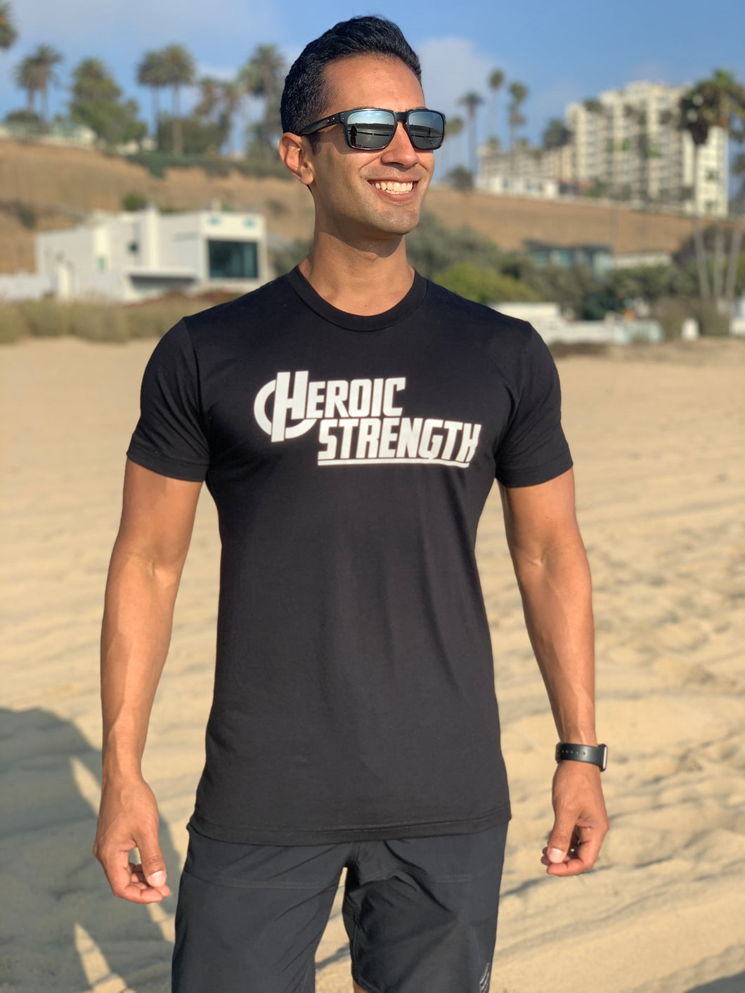 Saul wears the Heroic Strength T-Shirt in Black, Size Medium.