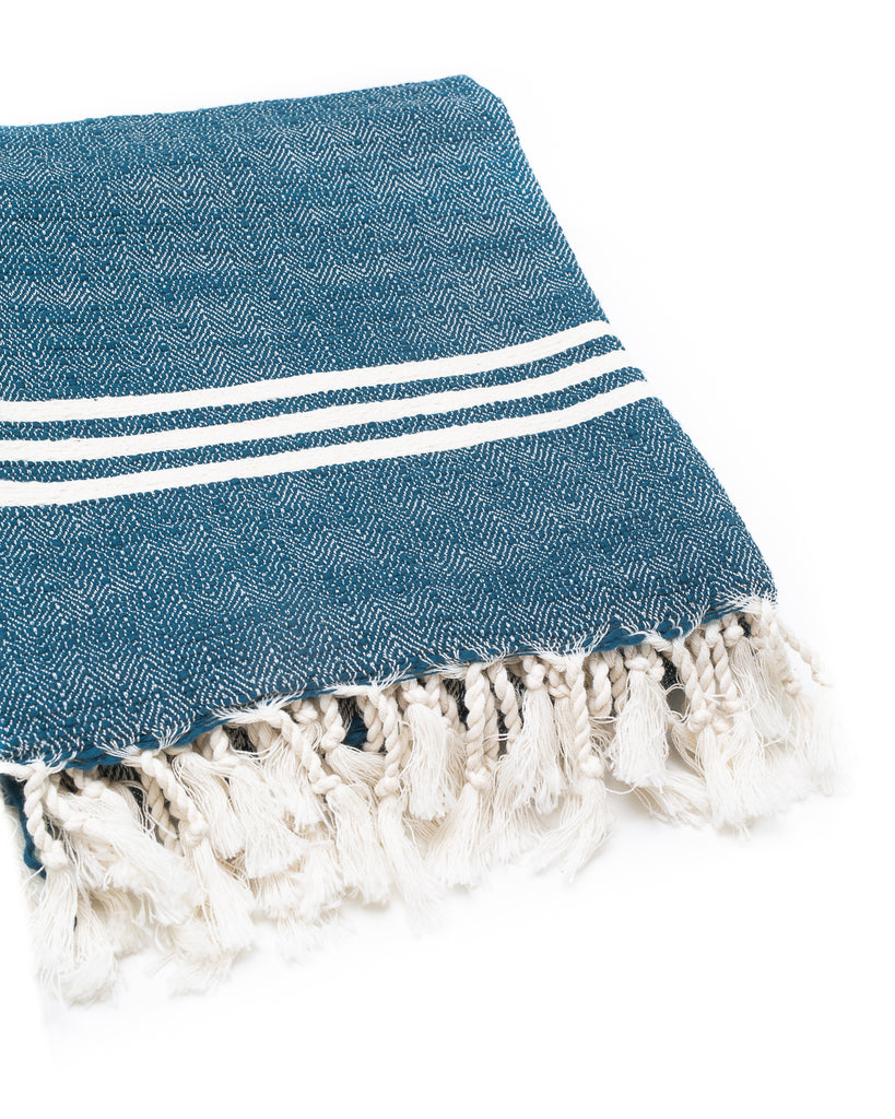 deep blue Turkish towel with cream mediterranean stripes on the edges