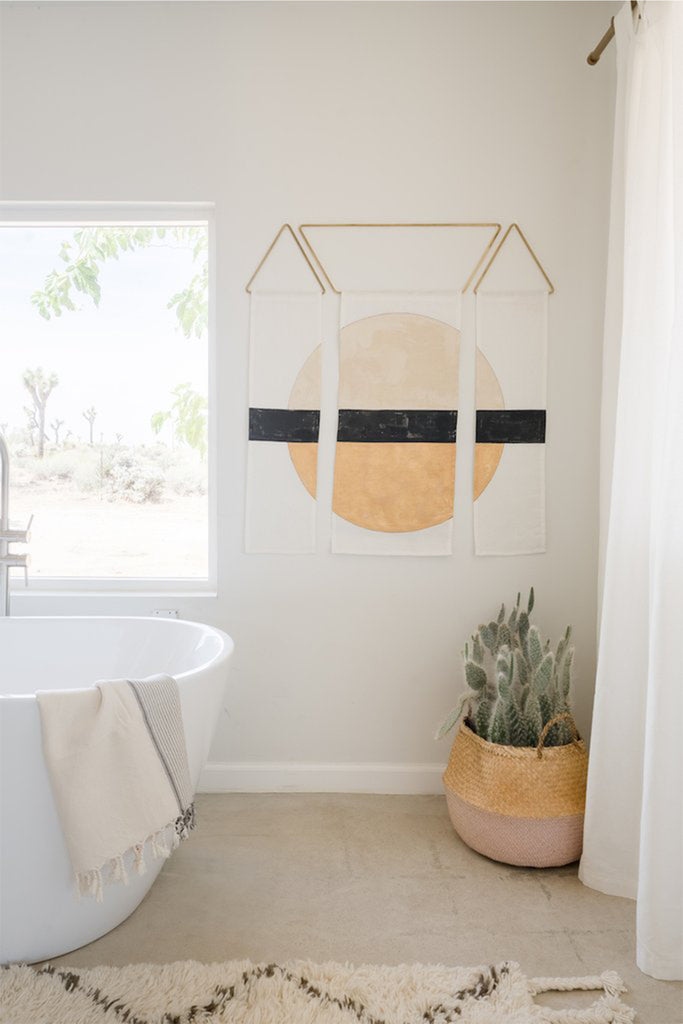 abstract wall art hanging in a bathroom
