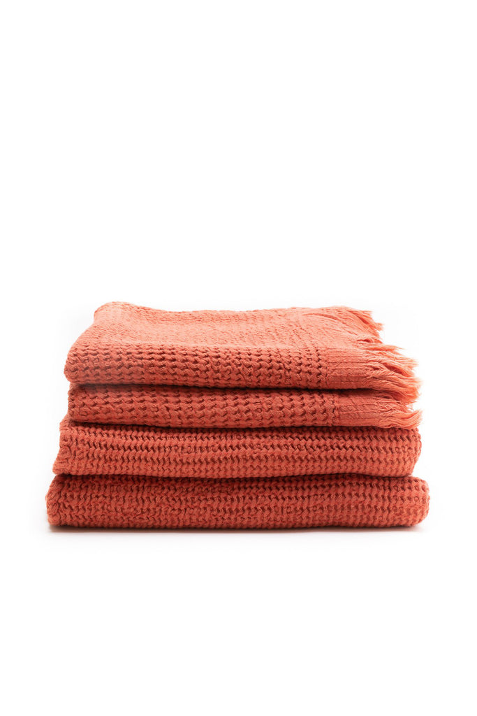 honey comb weaved hand towel in the color brick