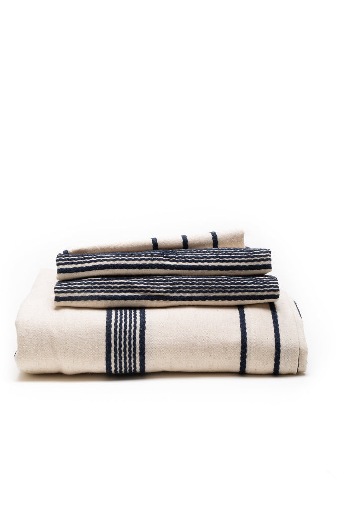 natural duvet cover set with navy colored thin stripes in-between
