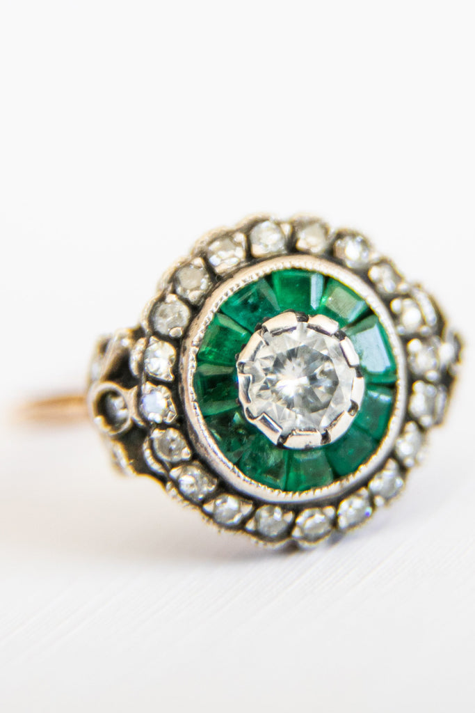 rounded emerald and diamond ring