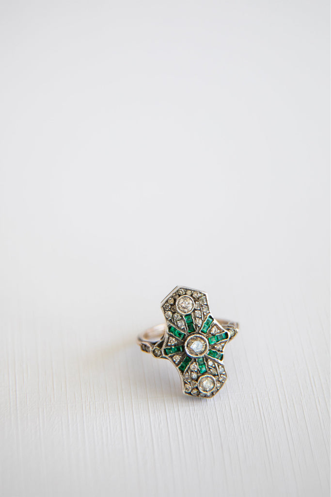 rectangular shaped diamond and emerald ring