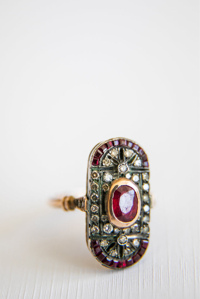 oval shaped diamond ring with ruby centered