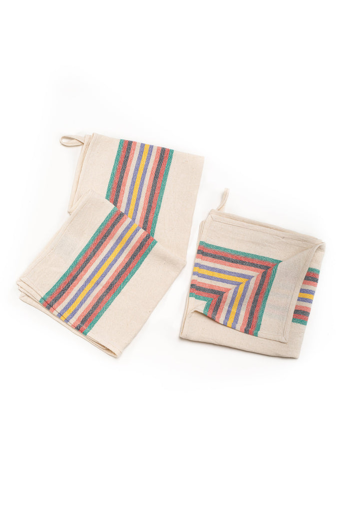 natural colored hand towel with thick horizontal rainbow stripes on the edges