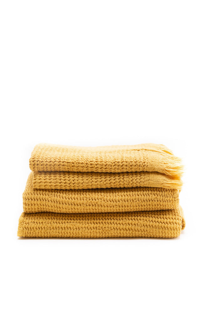honey comb weaved hand towel in the color mustard yellow