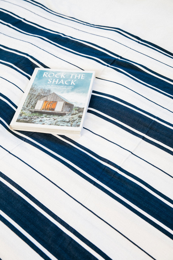 white and navy striped bedspread
