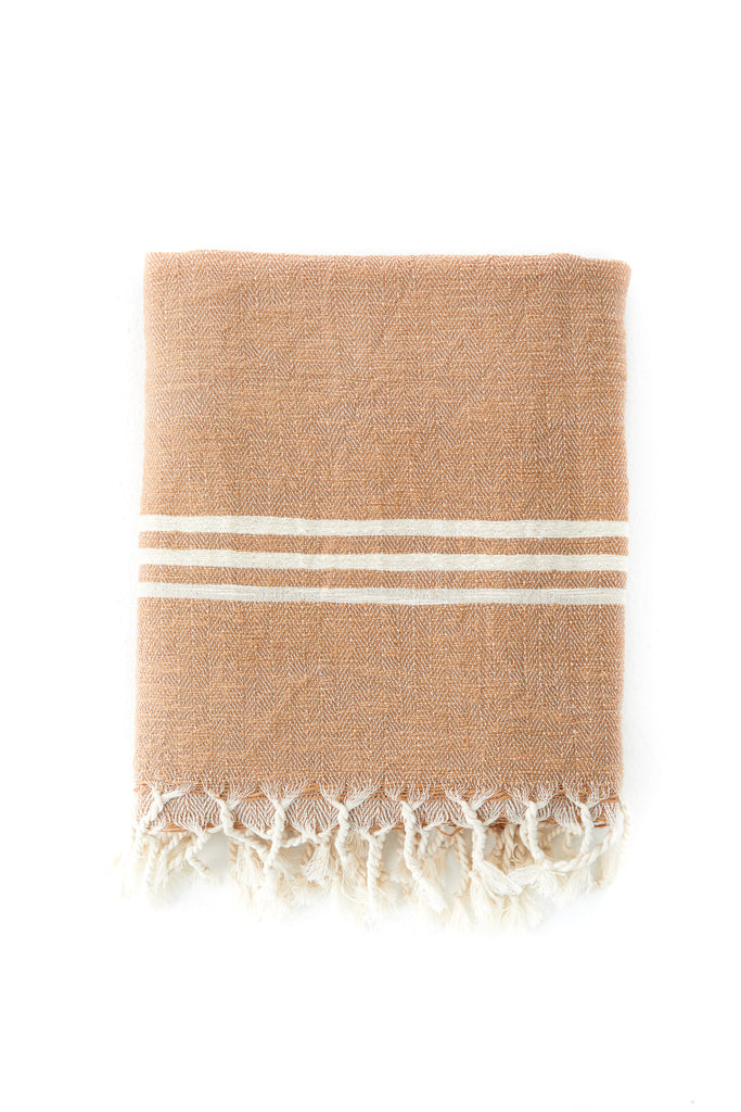 peachy cinnamon Turkish towel with cream mediterranean stripes on the edges