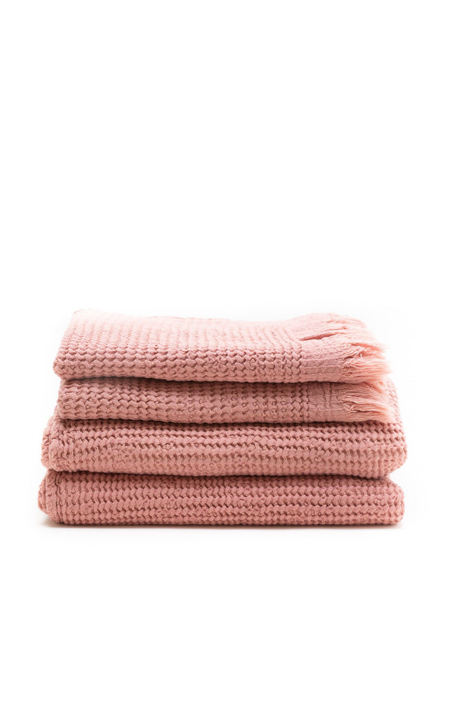 honey comb weaved hand towel in the color rose pink