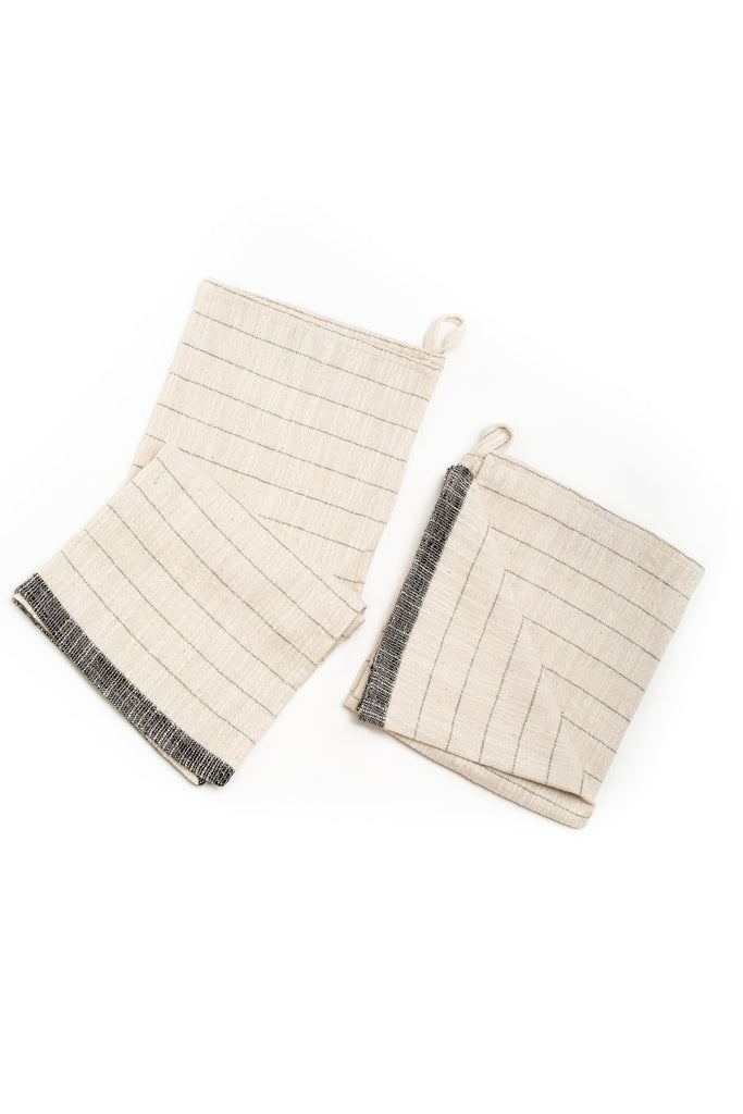 natural colored hand towel with grey thin stripes and a thick horizontal stripe