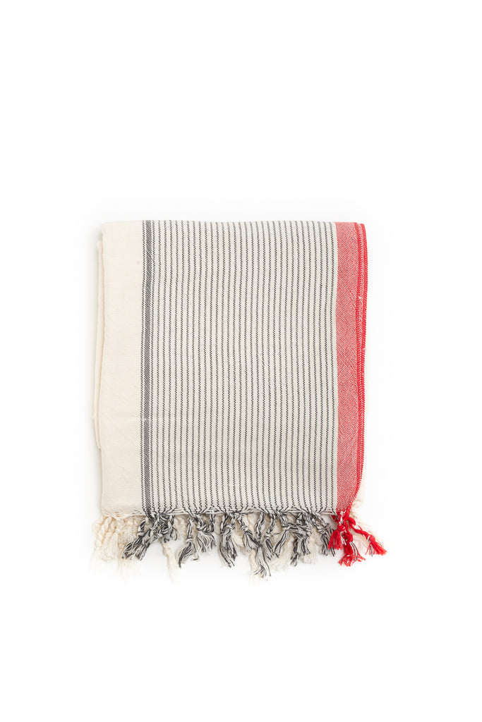 Turkish towel with dark grey stripes horizontally and red lining on the edge