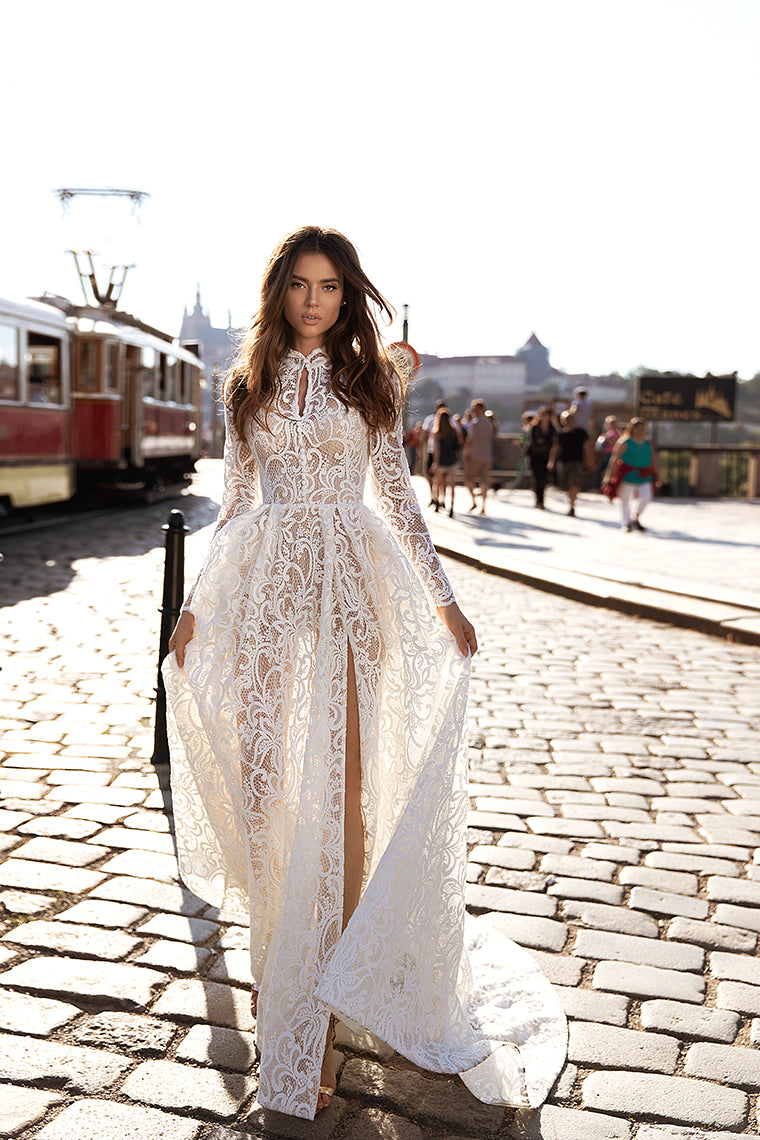 https://www.kchaute.com/collections/kc-luxury-couture-wedding-collection/products/casandra-long-sleeve-lace-sheath-ivory-wedding-dress