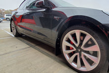 Load image into Gallery viewer, Tesla Model 3 with Rally Armor Mudflaps, 3/4 view