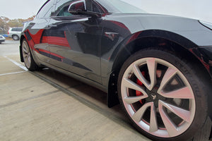 Tesla Model 3 with Rally Armor Mudflaps, 3/4 view