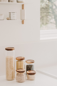 Glass and wood storage jars
