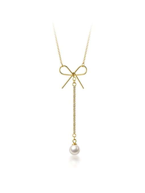 Gold Bow and Pearl Necklace
