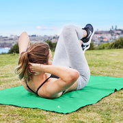 exercise towel transforms into a mat on grass