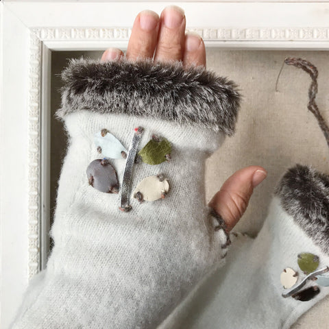 Winter white fingerless gloves in cashmere and faux fur with icy blue and metallic silver leather accents. Handmade in Maine by worthygoods.