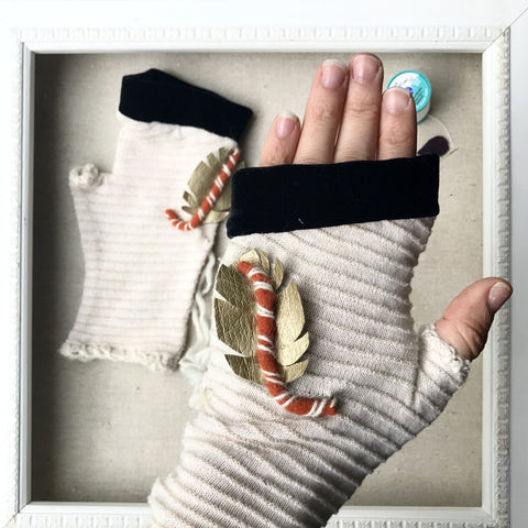 fingerless gloves in winter white knit with golden feather accent and black velvet handmade in Maine by worthygoods