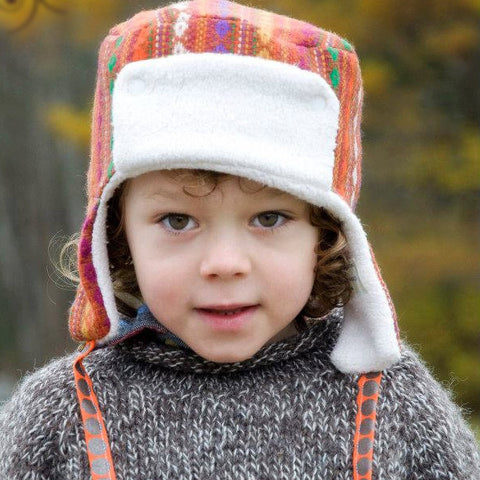 Boy wearing traditional New England trapper hat in wool and organic cotton sherpa by worthygoods.