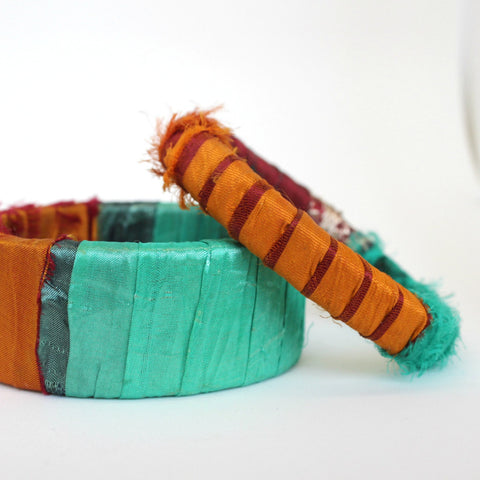 Pair of turquoise and mango sari silk wrapped wooden bangles hand made in Maine by worthygoods.