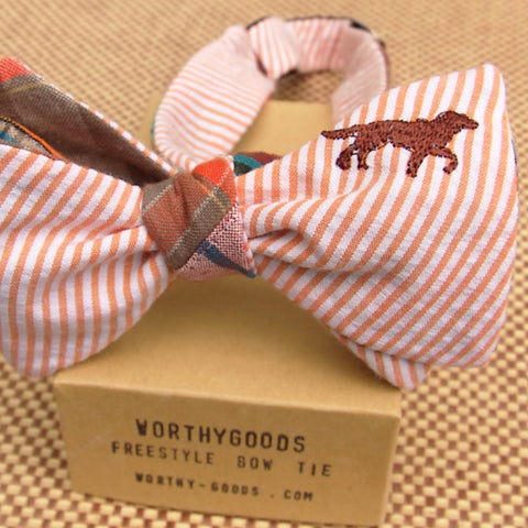 Bird dog bow tie in rust orange reversing to madras patchwork. Handmade in Maine by Dory Smith Graham of worthygoods.