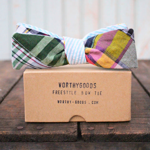 Preppy freestyle bow tie in bright madras reversing to blue seersucker on kraft gift box by worthygoods.
