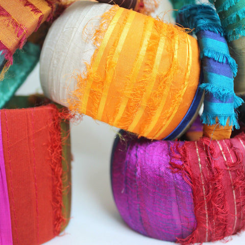 Bold sari silk bangles in statement hues of gold, indigo, pink and red. Handmade in Maine by worthygoods.