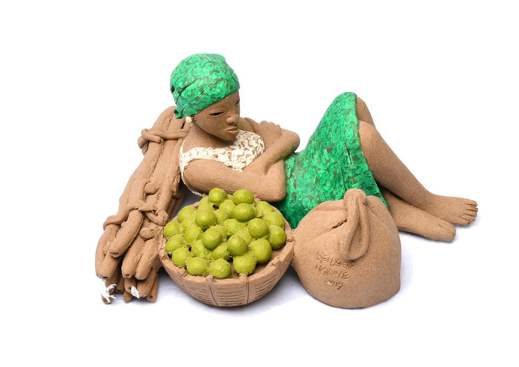 TERRACOTTA WOMAN RESTING ON WOOD - TOMATOES