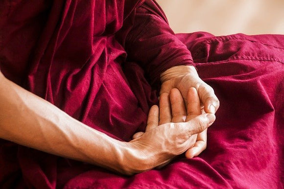 hands in lap of person meditating