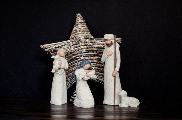 Nativity scene with white figures on black background