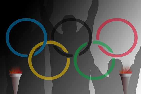 illustration with Olympic rings and shadows of people with raised arms in background