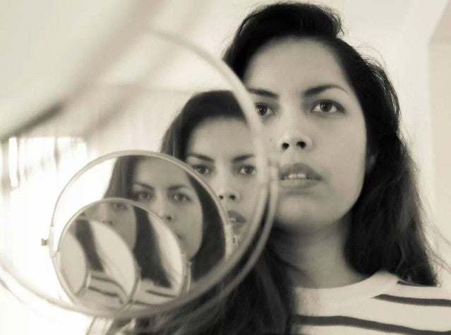 Woman in the mirror from Flickr via Wylio