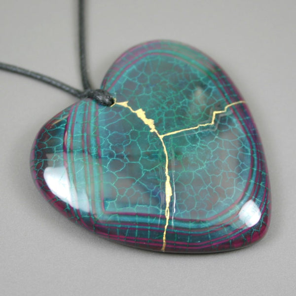 Kintsugi (kintsukuroi) teal green and purple dragon veins fire agate stone broken heart pendant with gold repair on black cotton cord