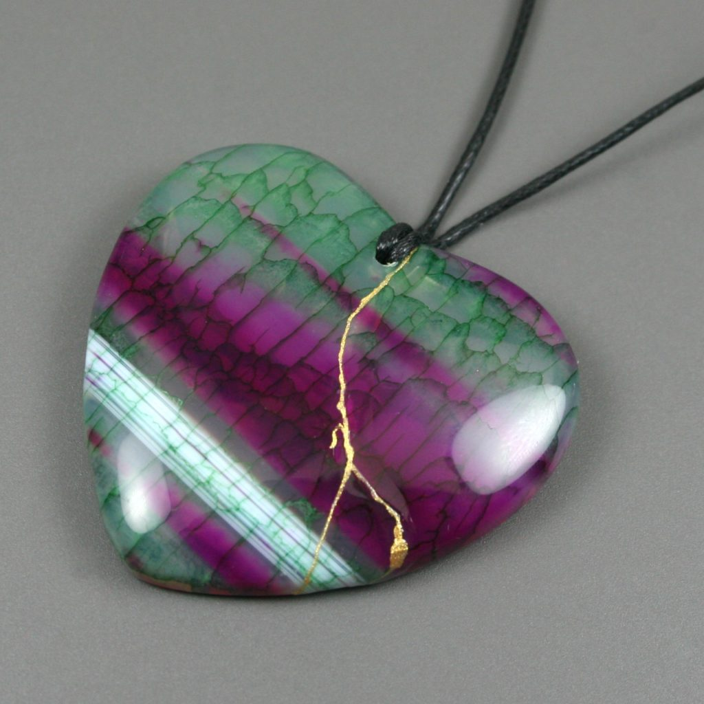 Kintsugi repaired green and purple dragon vens agate broken heart pendant on black cotton cord
