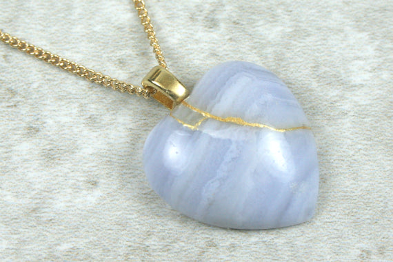 Broken heart pendant in blue lace agate stone with gold kintsugi (kintsukuroi) repair