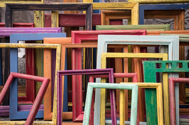 a collection of frames in many sizes, styles and colors