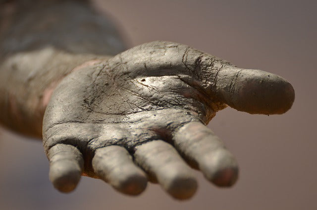 empty, dirty hand stretching toward viewer