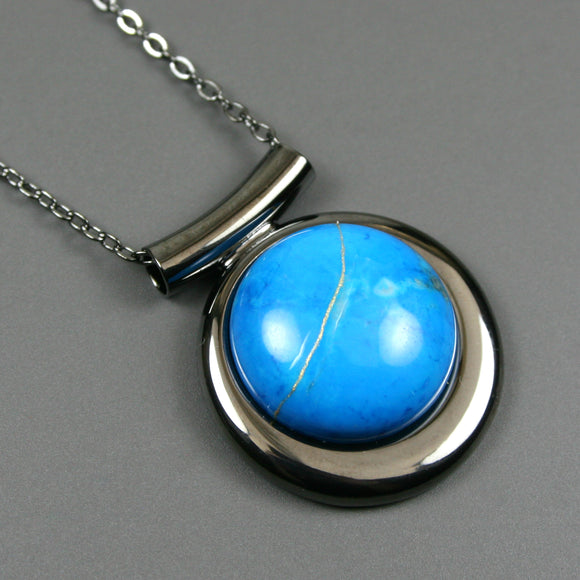 Turquoise howlite kintsugi pendant in a gunmetal setting on chain from A Kintsugi Life