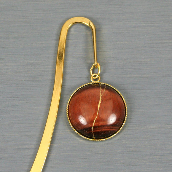 Red tiger eye with kintsugi repair on gold plated steel bookmark