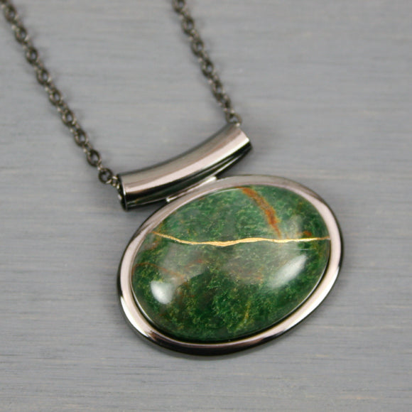 African jade kintsugi pendant in a gunmetal setting on chain from A Kintsugi Life