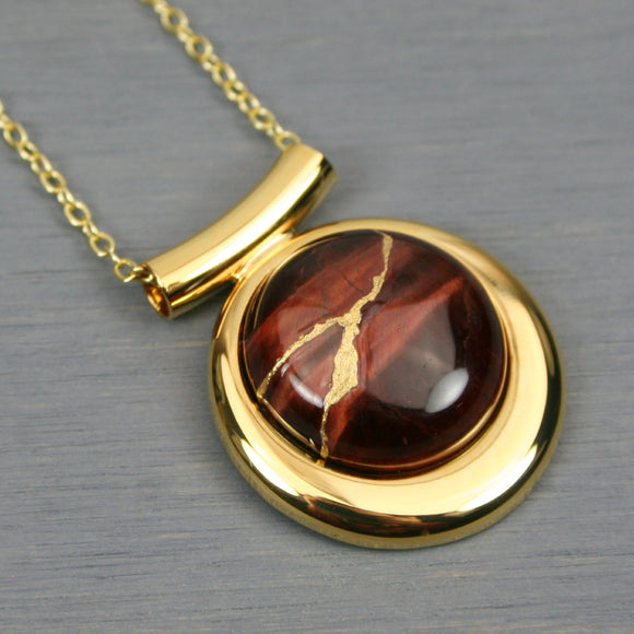 Red tiger eye kintsugi pendant in a gold setting on chain from A Kintsugi Life